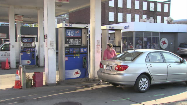 ws, man arriving on manhattan gas station, new york city, new york, usa - fuel pump stock videos and b-roll footage