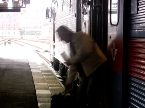 a man arriving with a train stockholm sweden. - one mature man only stock videos & royalty-free footage