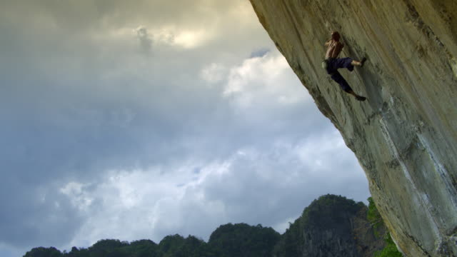 la ws man ascending rock face using finger-holds, falling off and hanging by rope, climbing back up / krabi, thailand - rock face stock videos & royalty-free footage