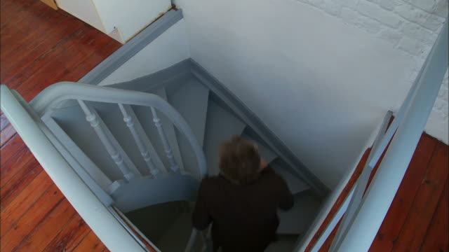 ms, ha, man ascending stairs in attic apartment, brussels, belgium - 45 49 years stock videos and b-roll footage