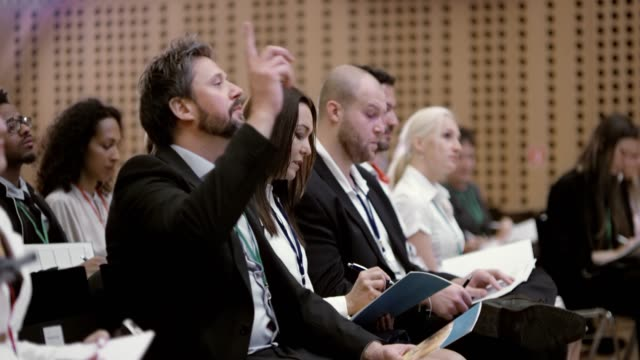 man asking a question at a seminar - business conference stock videos & royalty-free footage