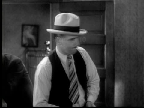 1931 b/w montage man asking gangster why he killed another man/los angeles, california, usa/ audio - stuhl stock-videos und b-roll-filmmaterial