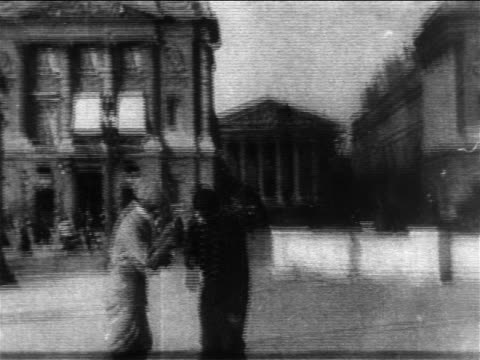 B/W 1904 man asking policeman directions on Paris street / Archives National in background / France