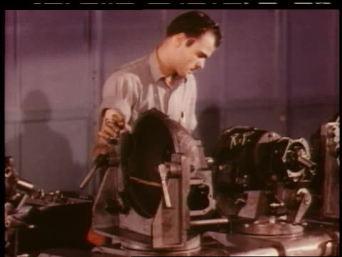 vídeos de stock, filmes e b-roll de 1951 man assembles car part in chevrolet factory - 1951