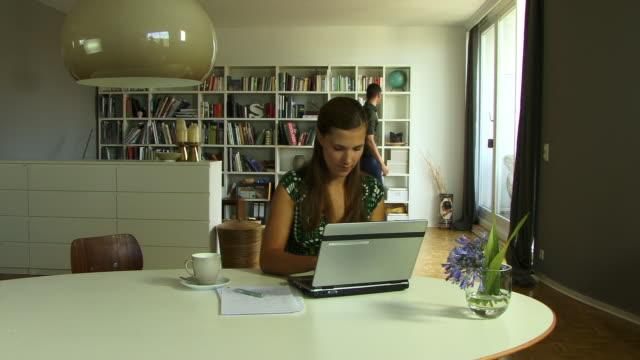 cu, man assisting woman using laptop - sideburn stock videos & royalty-free footage