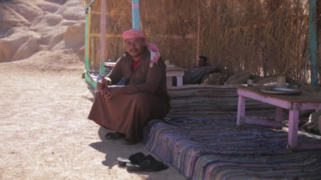 man at a bedouins village in the sinai desert close to sharm elsheikh - sinai egitto video stock e b–roll