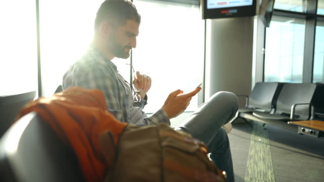 man at airport lounge using mobile phone - middle east stock videos & royalty-free footage