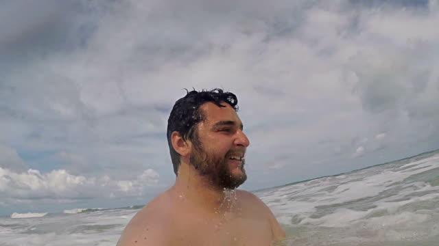 Man at beach waves