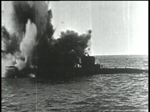 man at cannon / soldiers firing cannon / hit on the submarine