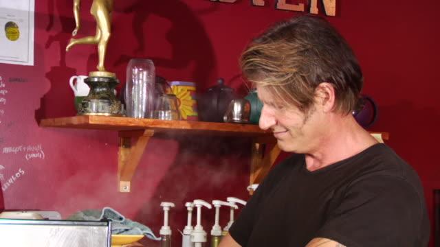ms man at coffee shop preparing espresso and pot of tea/ vancouver, bc  - kelly mason videos stock videos & royalty-free footage