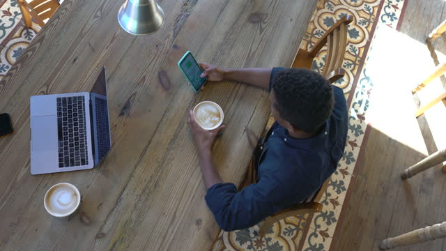 man at coffee shop using coronavirus tracking mobile app - rules stock videos & royalty-free footage