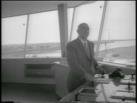 vídeos y material grabado en eventos de stock de man at controls in tower for lock system of st. lawrence seaway / canada / newsreel - only mature men