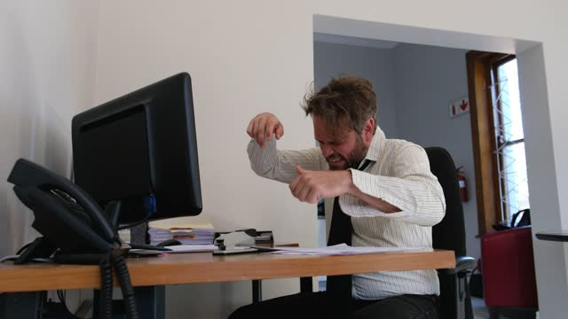 man at desk staples his finger by accident - blooper film clip stock videos & royalty-free footage