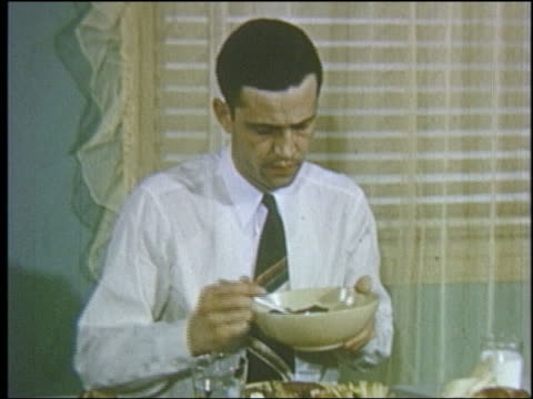 1952 man at dinner table being passed bowl of vegetables + declines them - 1952 stock videos & royalty-free footage