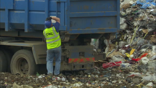 ms, man at dump truck in landfill site, ardley, oxfordshire, united kingdom - garbage truck stock videos and b-roll footage