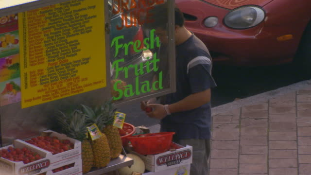 man at food stand in city, high angle - concession stand stock videos and b-roll footage