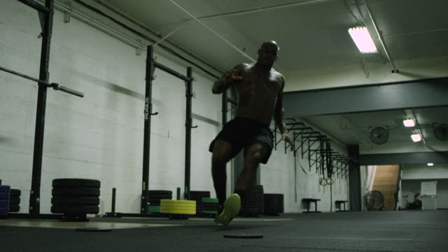 man at gym working out - cross training stock videos & royalty-free footage