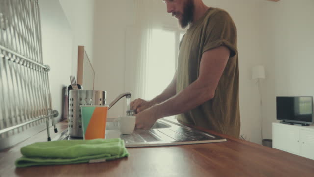 man at home, washing dishes - washing up stock videos & royalty-free footage