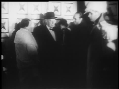 stockvideo's en b-roll-footage met b/w 1935 man at microphone introducing al smith at jumbo opening / hippodrome theater baltimore - al smith