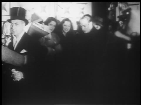b/w 1935 man at microphone introducing fanny brice at jumbo opening / hippodrome theater - 1935 stock videos and b-roll footage