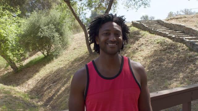 man at park - tank top stock videos & royalty-free footage