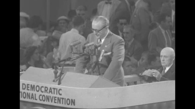 man at podium at the democratic national convention sam rayburn comes up behind him and strikes gavel man continues reading statement from sen estes... - sam rayburn video stock e b–roll