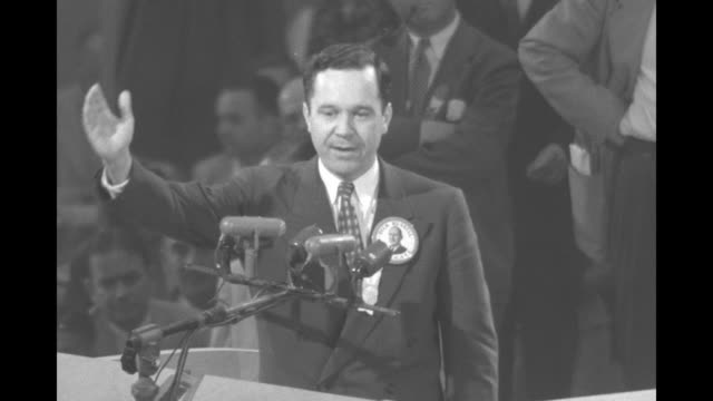 LS man at podium bangs gavel and asks people to be seated at the Democratic National Convention in the International Amphitheatre / SOT Russell B...