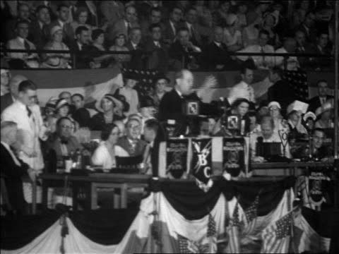 b/w 1932 man at podium people standing up on platform at democratic national convention - 1932 stock videos and b-roll footage