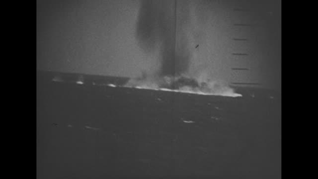 vídeos de stock, filmes e b-roll de vs man at submarine periscope's viewfinder and pov ship seen above through the scope ship's commander at scope barks order huge ship explosion seen... - veículo aquático militar