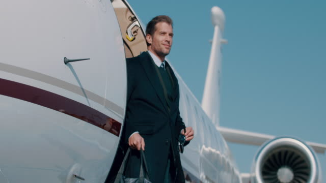 man at the airport - private jet stock videos & royalty-free footage
