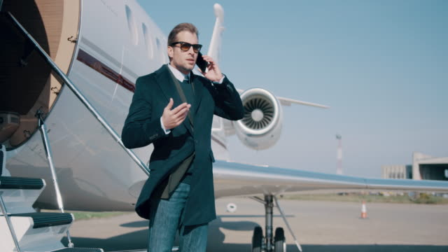 man at the airport - corporate jet stock videos & royalty-free footage