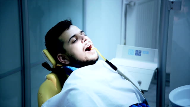 man at the dentist - young men stock videos & royalty-free footage