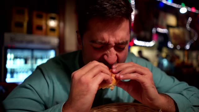 man at the pub disliking his ordered burger - negative emotion stock videos & royalty-free footage