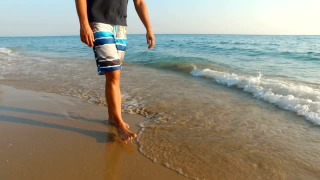 man at the sandy beach - swimwear stock videos & royalty-free footage