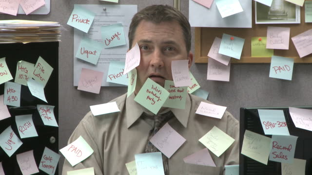 man at work covered with sticky notes  - office partition stock videos & royalty-free footage