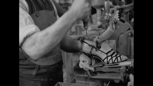 cu man attaches heel to sandal; 1956 - production line worker stock videos & royalty-free footage