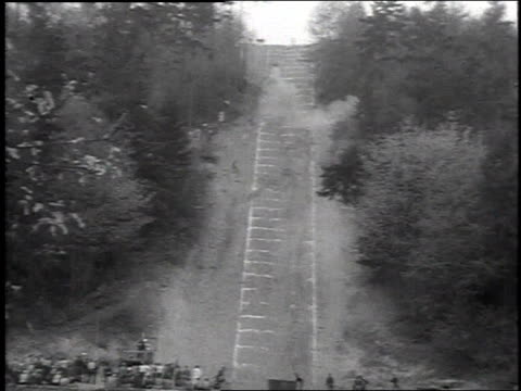 1954 MONTAGE Man attempts motorcycle hill climb / Jolly Roger Hill, Seattle, Washington, United States