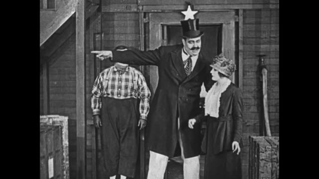 1919 Man (Fatty Arbuckle) attempts to come to the aid of a strongman's assistant (Molly Malone) who is forced to carry five suitcases