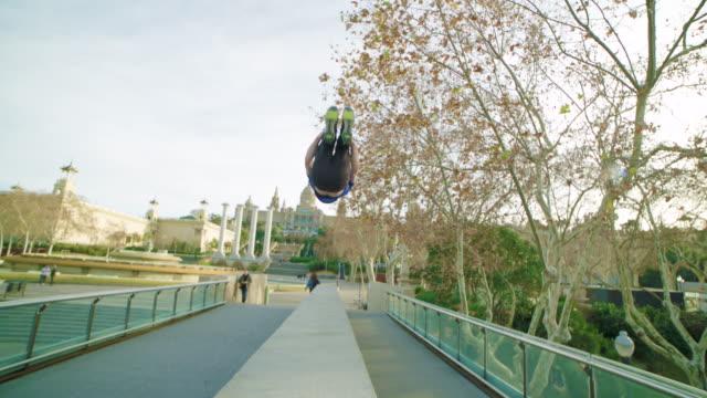 Man backflipping at Plaça Espanya Montjuic, Barcelona