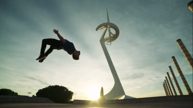 Man backflipping at sunset at Montjuic, Barcelona