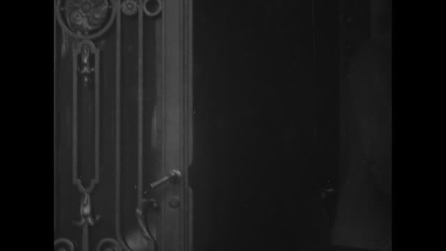 cu man backs inside past cast iron grillwork at entrance of the mccormick apartments home of us treasury secretary andrew mellon as the gate closes... - cast iron stock videos and b-roll footage