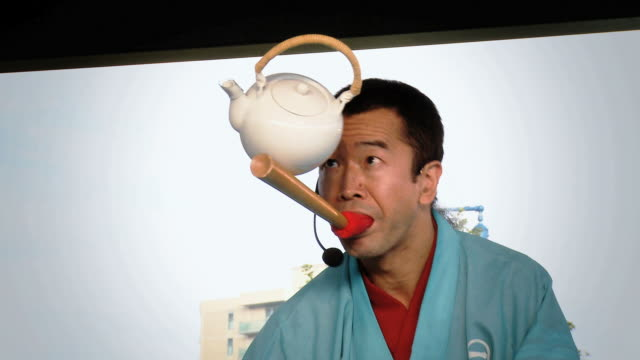 vidéos et rushes de ms man balancing tea pot on wooden stick /  mississauga, ontario, canada. - kelly mason videos