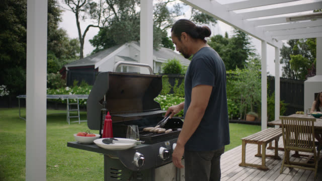 man barbecues sausages - barbecue stock videos & royalty-free footage