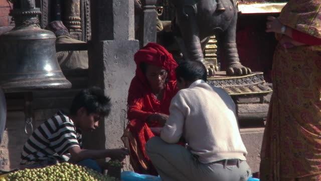 Man bartering in village marketplace in Nepal.