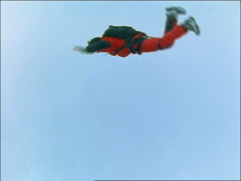 man base jumping off of mountain in snowstorm - 1997 stock videos & royalty-free footage