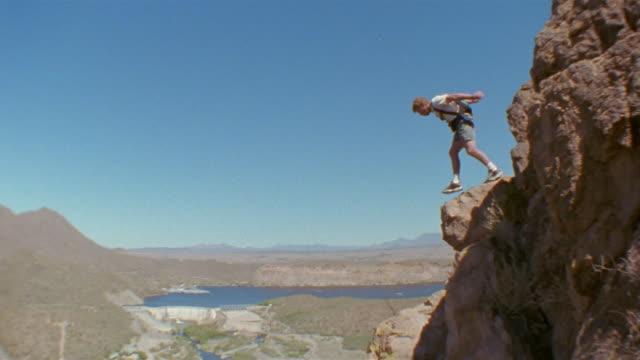 MS, Man base jumping, Saguaro Lake, Arizona, USA