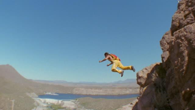 ha, td, man base jumping, saguaro lake, arizona, usa - base jumper stock videos & royalty-free footage