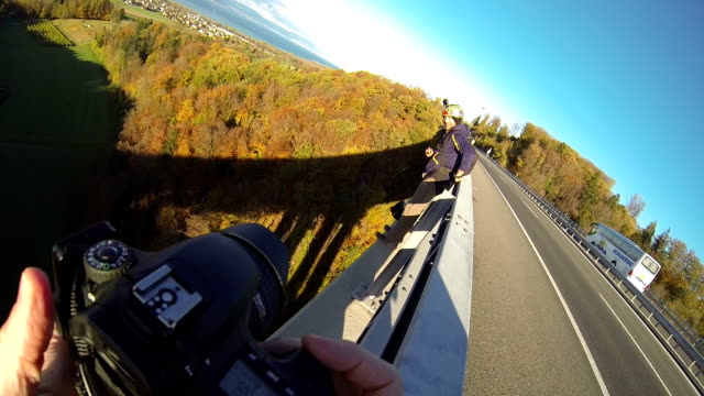man base jumps from high bridge - base jumper stock videos & royalty-free footage