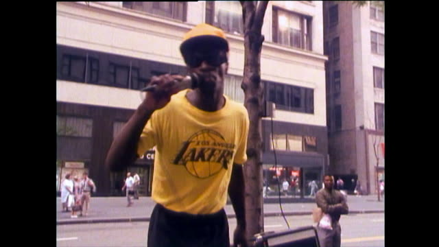 vídeos de stock, filmes e b-roll de a man beatboxes on a street in chicago; 1989 - 1980 1989