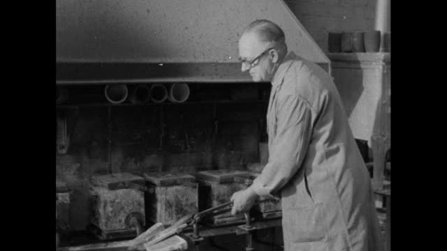 man beats gold ingot with mechanical hammer; 1956 - gold leaf stock videos & royalty-free footage